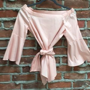 Rose color, three quarter bell sleeve top.